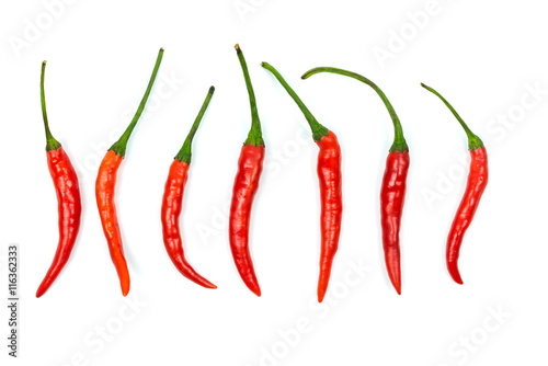 Photo  Top view of red chilli peppers on white background