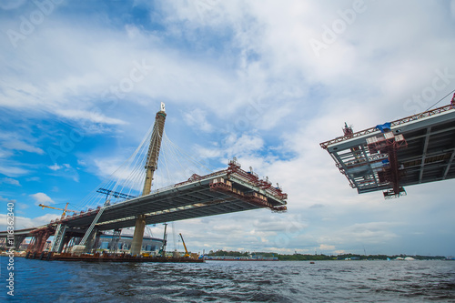 Foto op Canvas Bruggen beautiful cable-stayed bridge in the construction process. summe