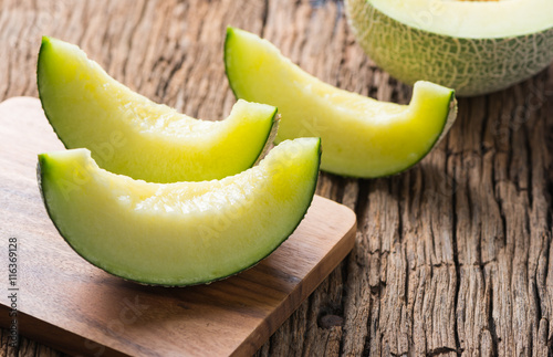sliced japan melon on wood plate