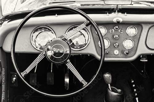 Fotografija  Steering wheel and dashboard in historic vintage car