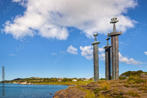 Obraz na plátne Three large swords stand on the hill as a memory to the Battle of Hafrsfjord in year 872 in Stavanger, Norway