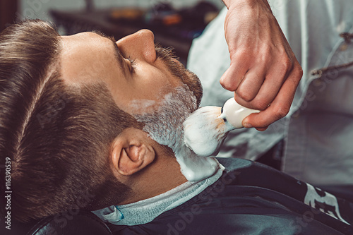 Stampa su Tela Hipster client visiting barber shop
