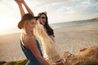canvas print picture - Female friends enjoying a day at sea coast