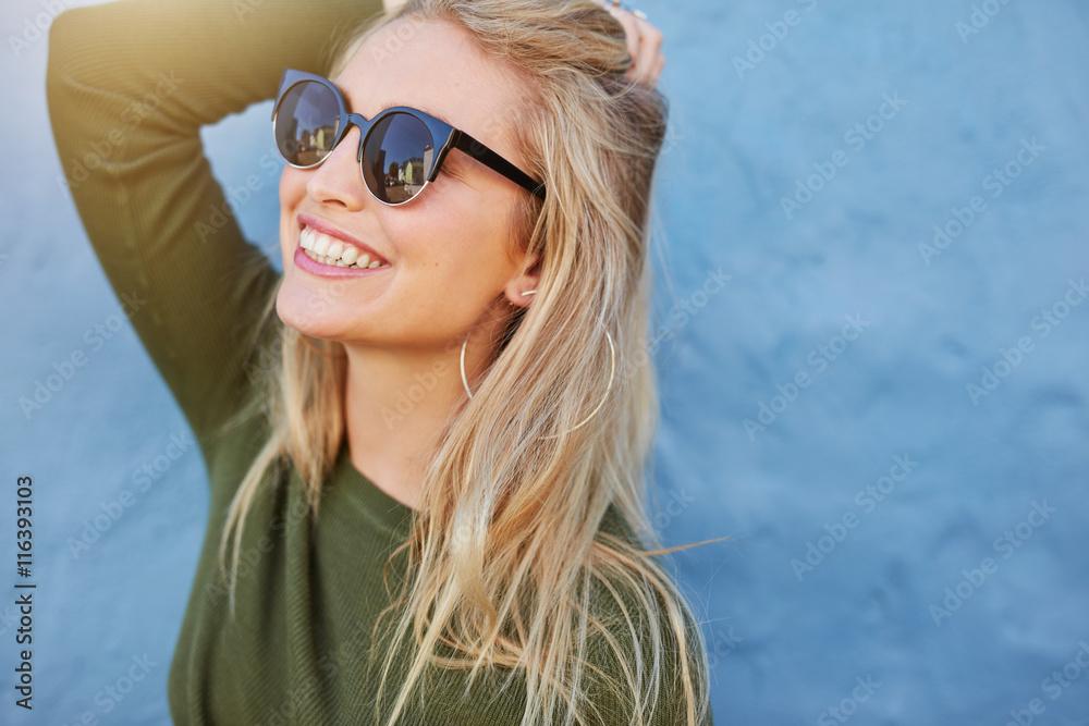 Fototapeta Cheerful young woman in sunglasses