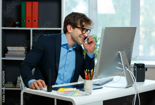 Fototapety, obrazy: Handsome young man working from home office