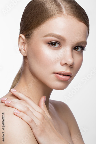 Valokuvatapetti Beautiful young girl with a light natural make-up and French manicure