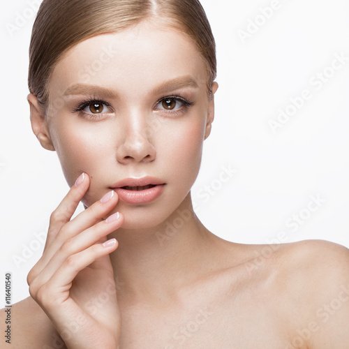Valokuva  Beautiful young girl with a light natural make-up and French manicure