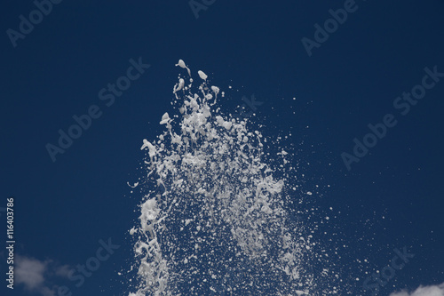 Splashing streams of water from a  fountain on sky background Canvas Print