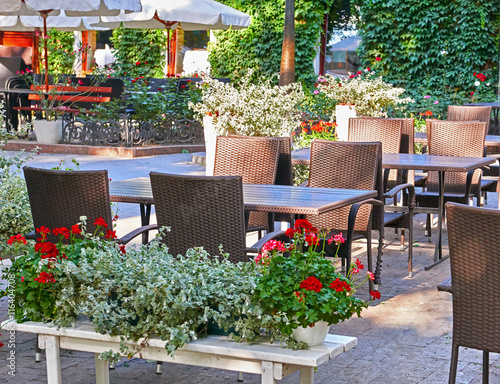 Aluminium Prints Bonsai summer street cafe interior in green city park, ornate with flowers and decorative elements