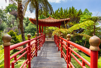 Fototapeta Orientalny Lovely park on the island of Madeira - Monte Palace Tropical Garden. The red Chinese-style pavilions.