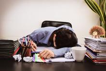 Businessman Asleep At Office D...