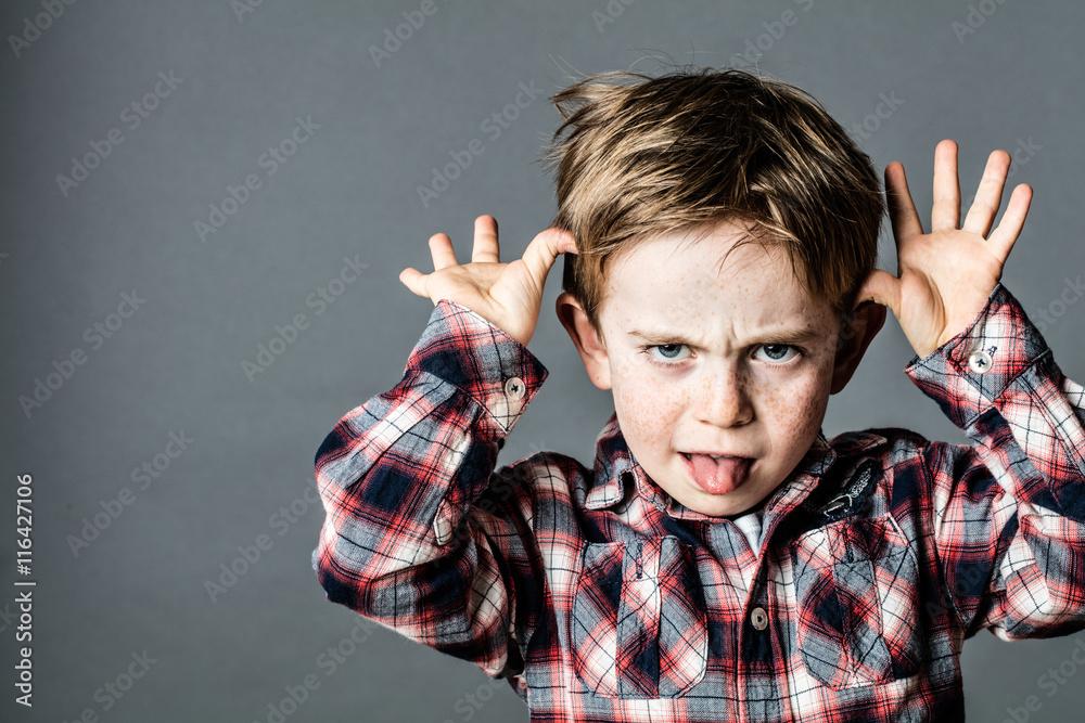 Fototapety, obrazy: angry little brat enjoying making a grimace for misbehavior