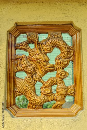 dragon in the window of a Chinese temple in kuala lumpur, Malaysia Poster