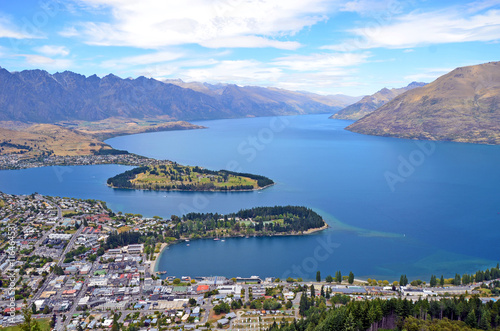 Aluminium Prints New Zealand Scenic view of Queenstown and surrounding rugged mountain range (The Remarkables) on the shores of the glacial Lake Wakatipu, New Zealand