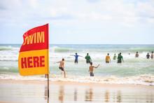 SWIM HERE Red Flag On The Beach