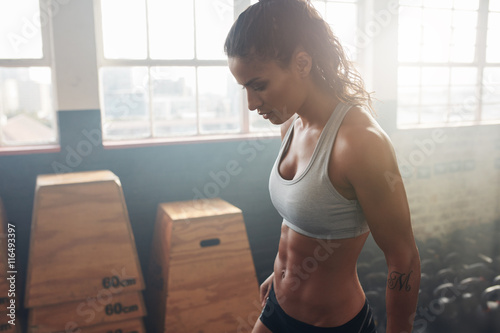 Fotografie, Obraz  Fitness female taking a break from intense workout at the gym