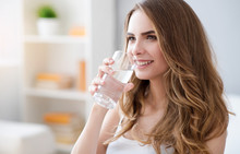 Positive Woman Drinking Water