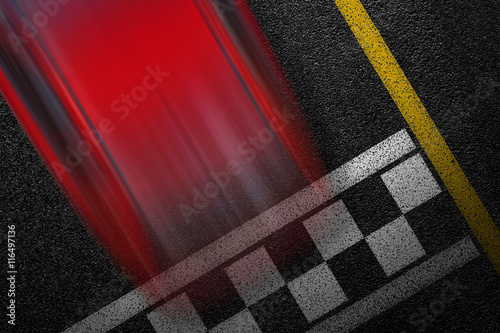 Fotografía  Level asphalted road with a dividing stripes and moving with high speed a red sport car