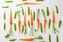 Raw Carrots And Green Peas Pat...