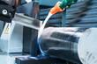 Automatic bandsaw sawing metal workpiece.