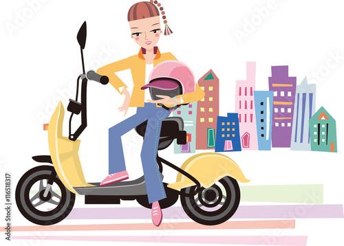 若い女性が街でバイク