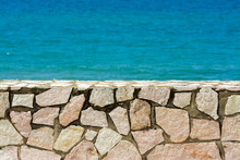 Background Small Wall By The Shore In Sicily, Italy