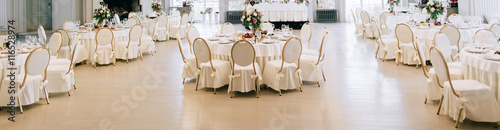 Fotobehang Restaurant Elegant wedding reception white table arrangement, floral centerpiece decoration, restaurant