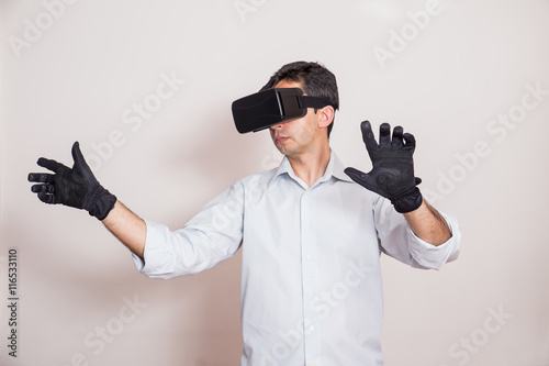 529a8dce3abf Man using virtual reality glasses and gloves - Buy this stock photo ...