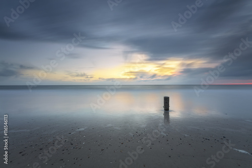 Stormy Seascape Sunset In Long Exposure Poster
