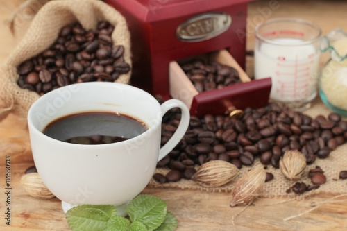 Fototapety, obrazy: Coffee grinder with coffee beans and cup espresso.