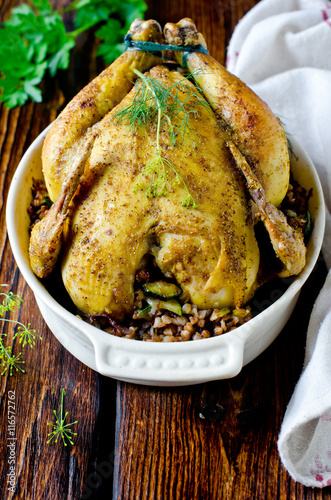 Fototapeta Baked chicken stuffed with buckwheat and zucchini obraz