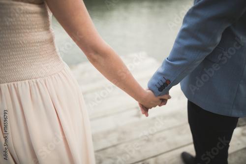 Poster de jardin Vache Wedding couple, bride, groom walking and posing on pier