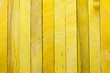 Rough wood texture painted in yellow for background