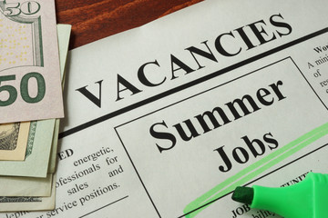 Newspaper with ads summer jobs vacancy. Occupation concept.