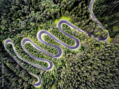 Poster de jardin Vue aerienne Drone view of a curvy road in Romania