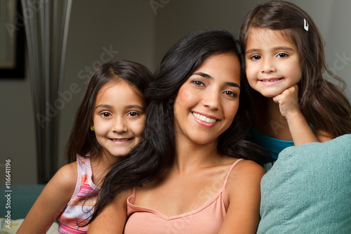 Photo  Hispanic mom and her two daughters