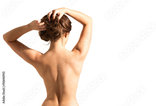 A beautiful woman, back view, naked back. Isolated on white background