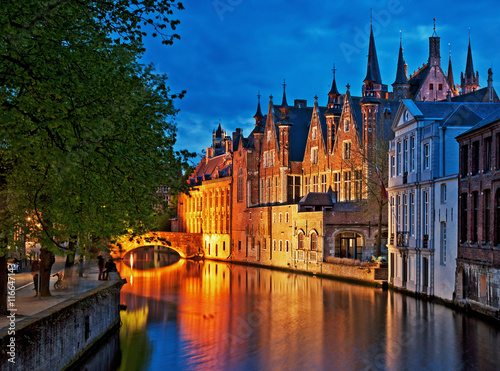Poster Bridges Night shot of historic medieval buildings along a canal in Bruges, Belgium