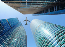 Airliner Flying Over Skyscrapers