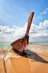 Fototapeta Morze Wooden traditional boat on the beach - Thailand