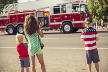 Kids Watching An Independence Day Parade