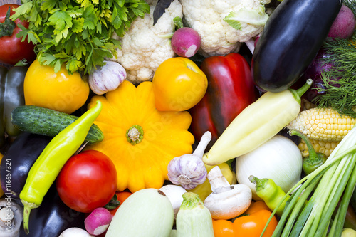 Fotobehang Background of fresh vegetables and greens closeup
