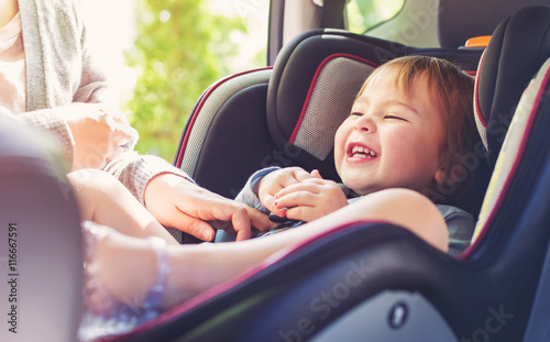 Toddler girl in her car seat Fototapeta