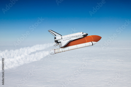 Space shuttle taking off to the sky