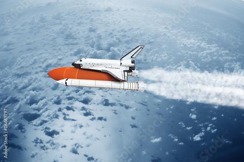 Fototapeta Space shuttle taking off to the sky ( NASA image not used ) obraz na płótnie