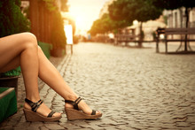Woman's Legs Wearing Sandals