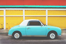 Side View Of Classic Car Parked On Street In City - Vintage Retro Color Effect Styles