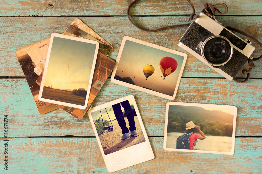 Fototapety, obrazy: Photo album remembrance and nostalgia in summer journey trip on wood table. instant photo of vintage camera - vintage and retro style