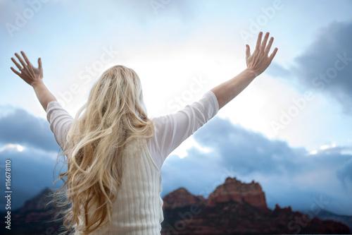 Valokuva  Woman with raised hands.