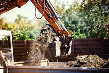 Industrial Backhoe Excavator Moving Earth On Construction Site